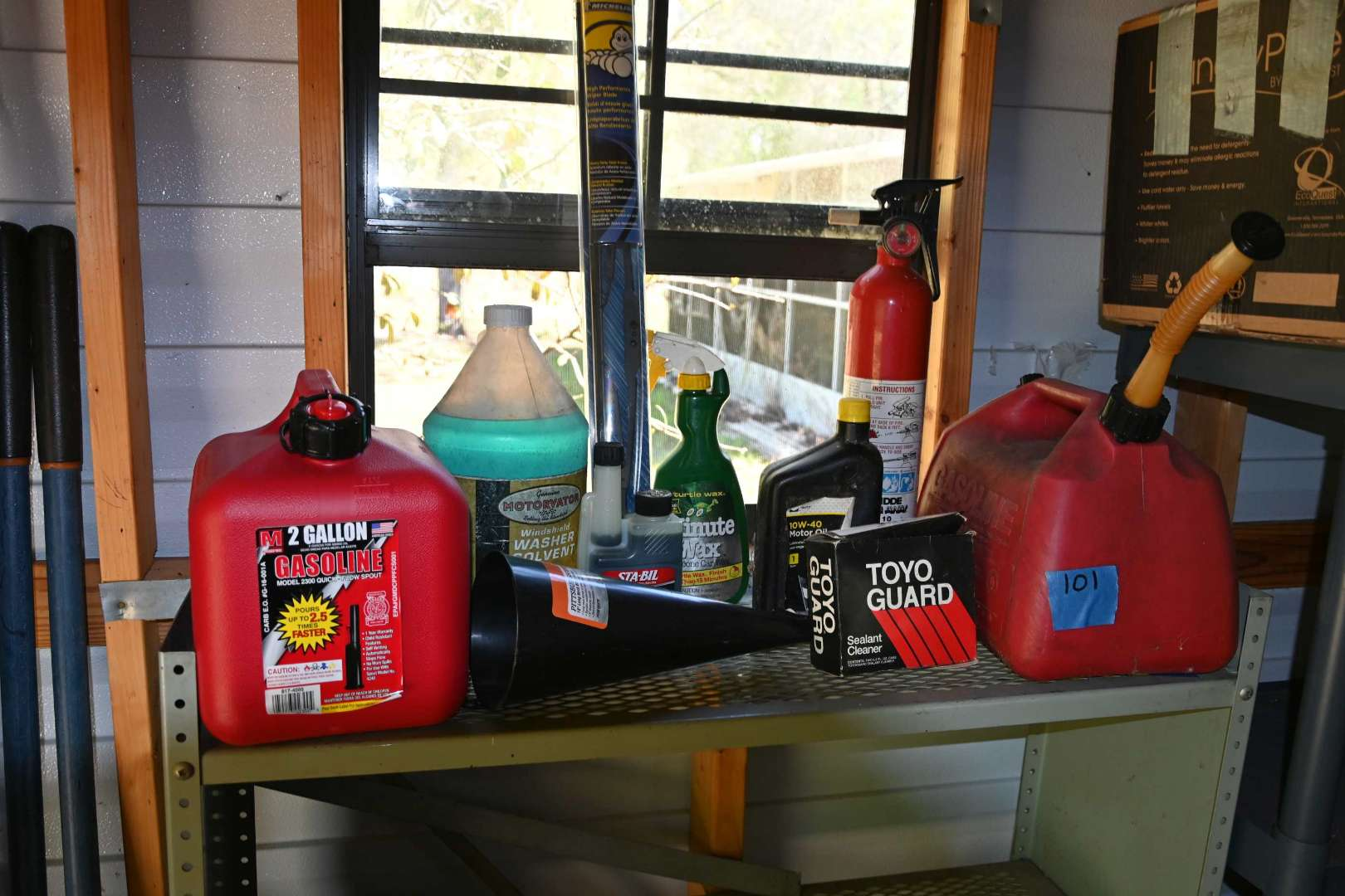 Lot # 101 Contents of shelf & fuel cans