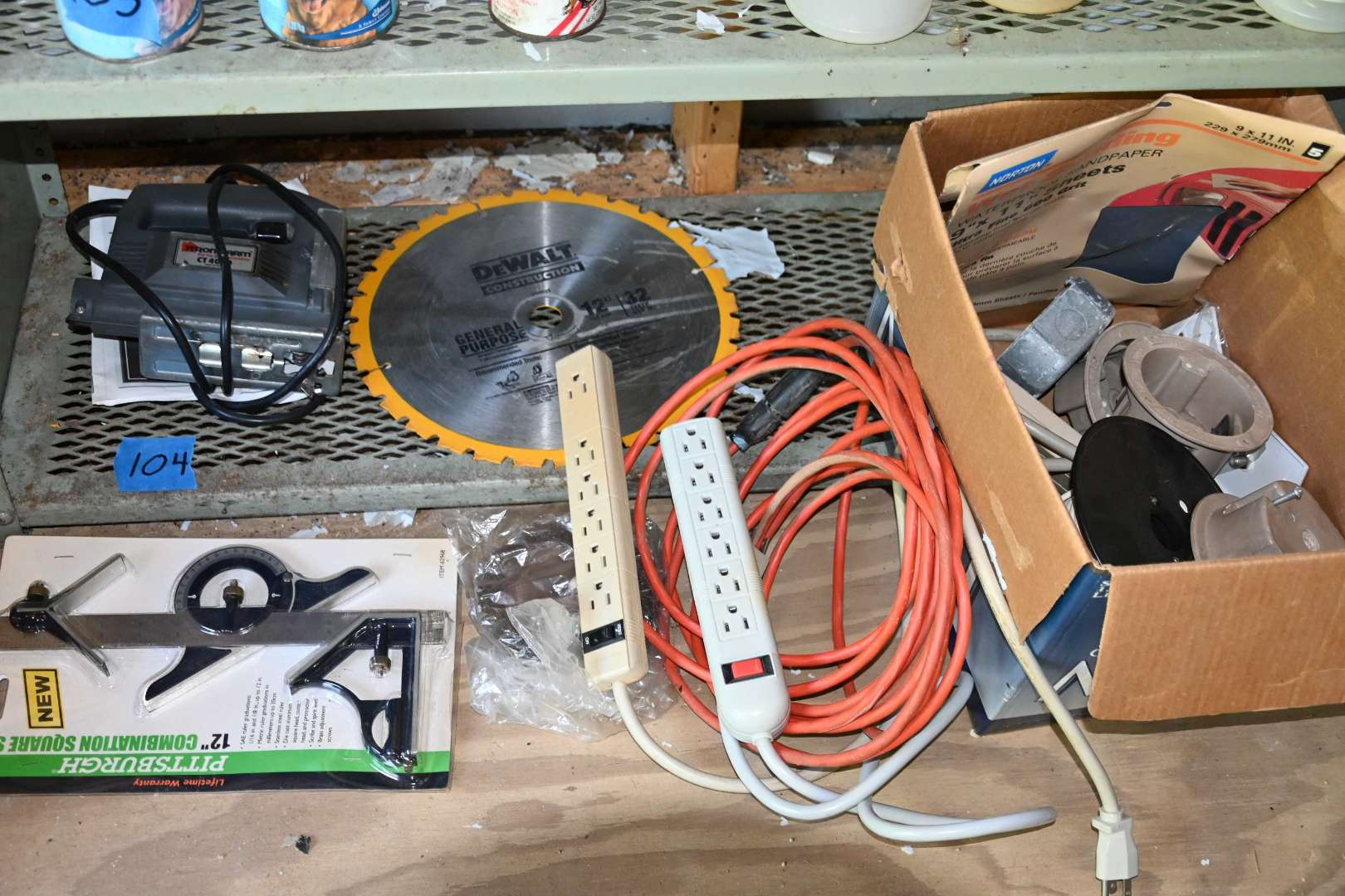 Lot # 104 Contents of shelf, tools, levels, extension cord, blade