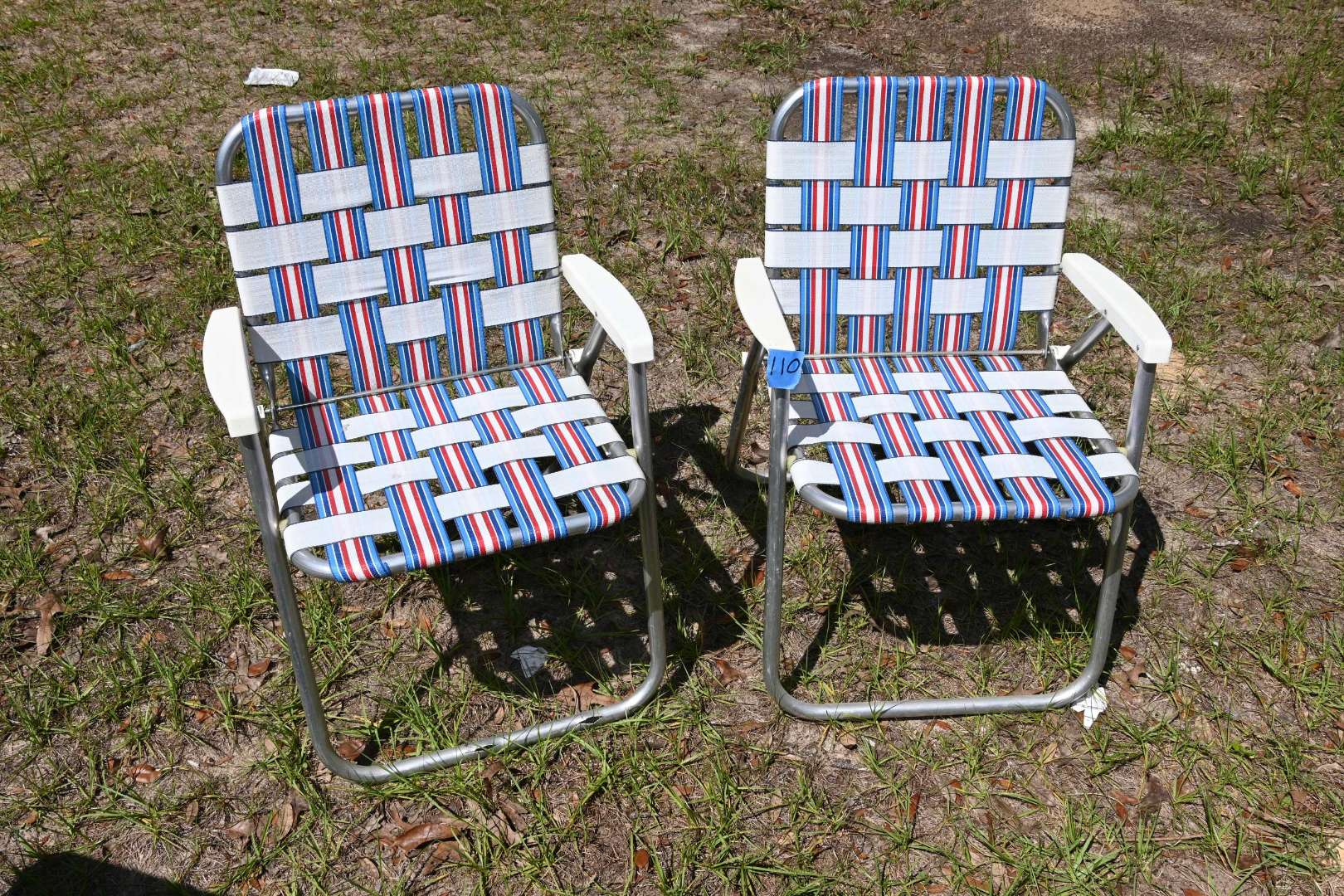 Lot # 110 Two like new lawn chairs