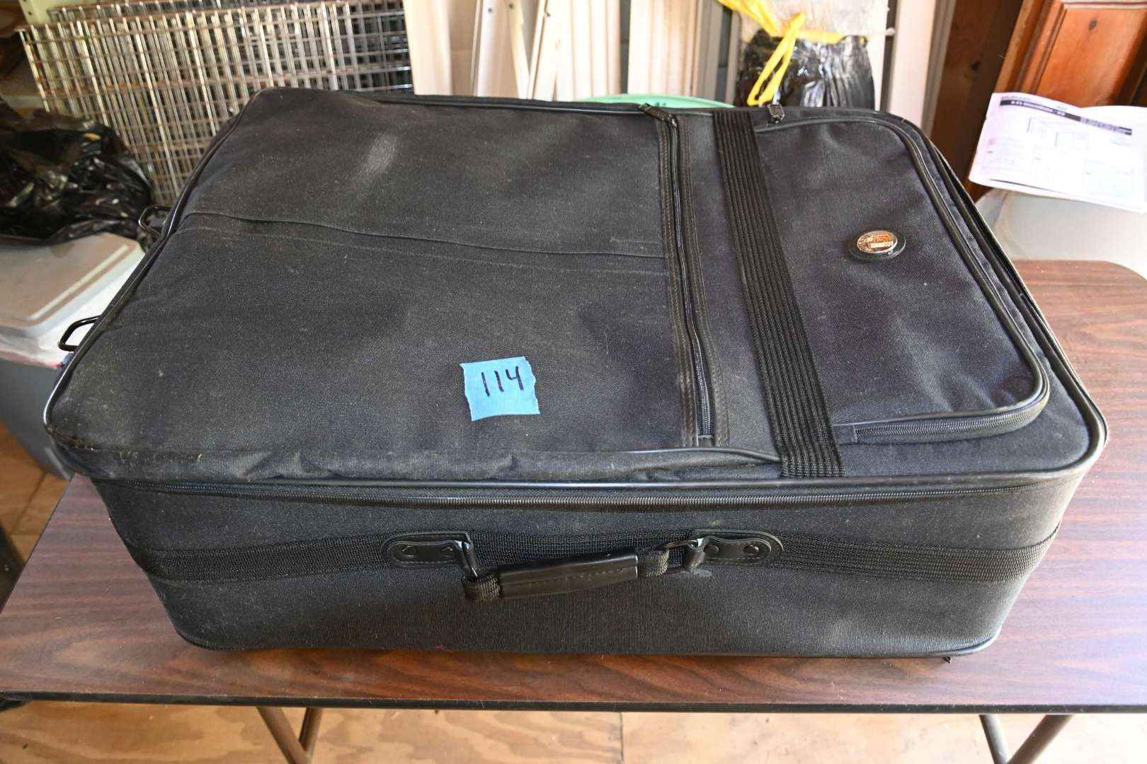 Lot # 114 Large OLYMPIA rolling suitcase