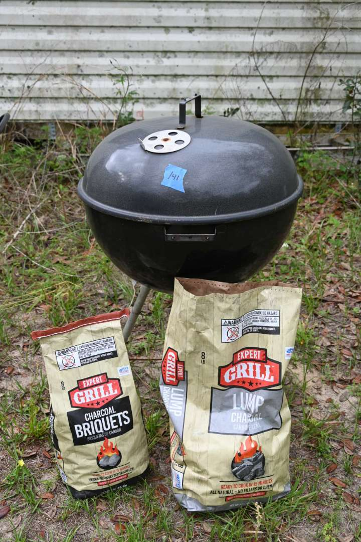 Lot # 141 WEBER charcoal grill with 2 bags  charcoal