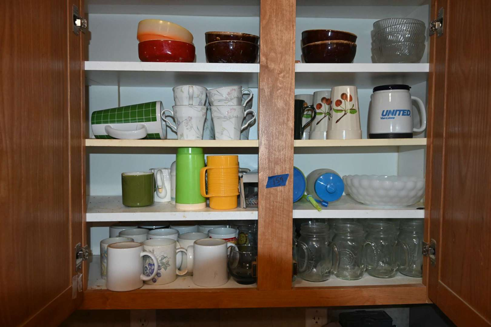 Lot # 159 Contents of right upper kitchen cabinet