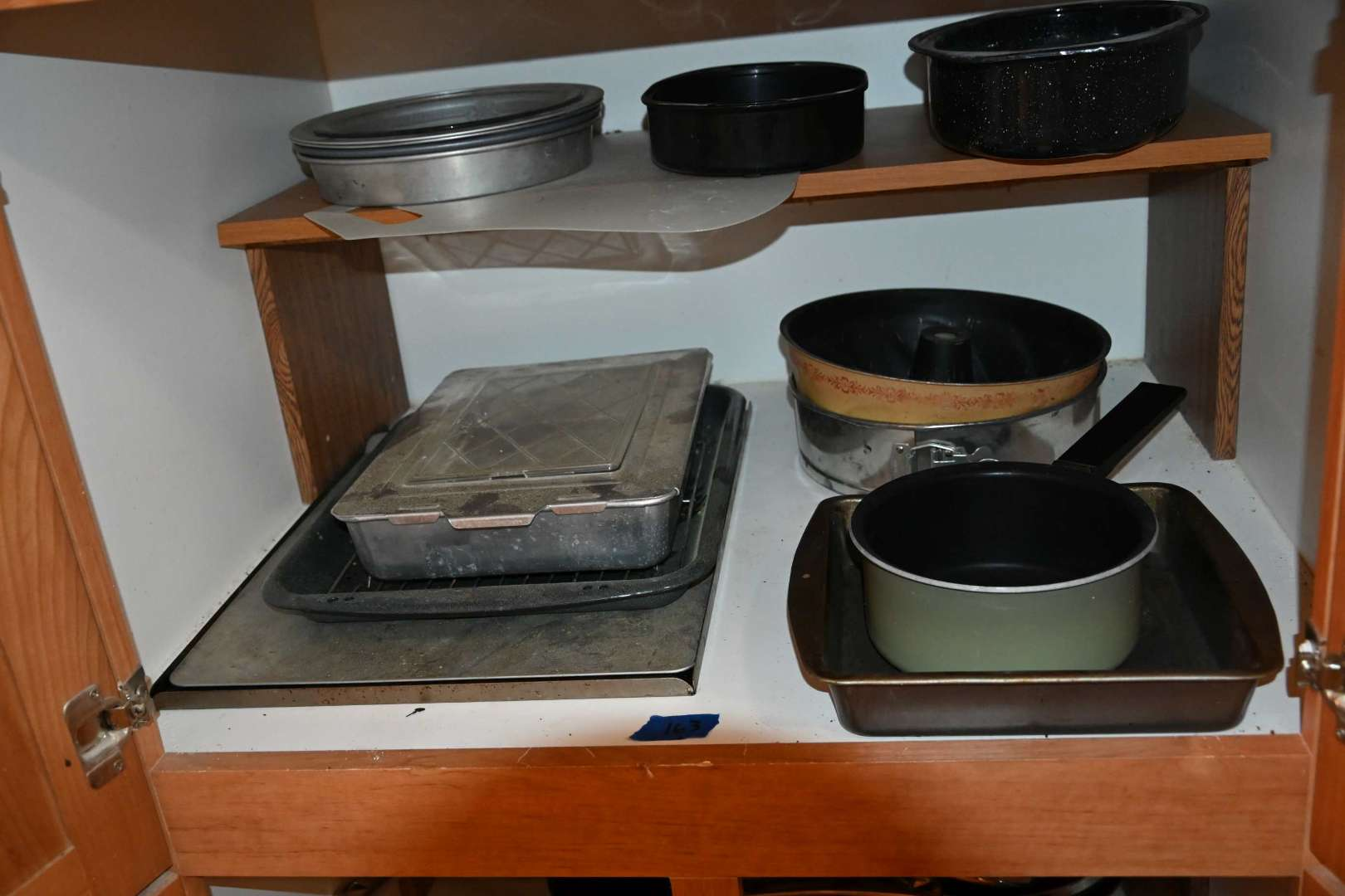 Lot # 163 Contents of middle tall cabinet