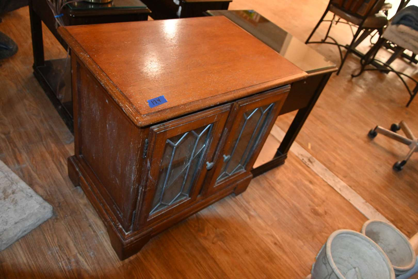 Lot # 174 Side table with glass doors