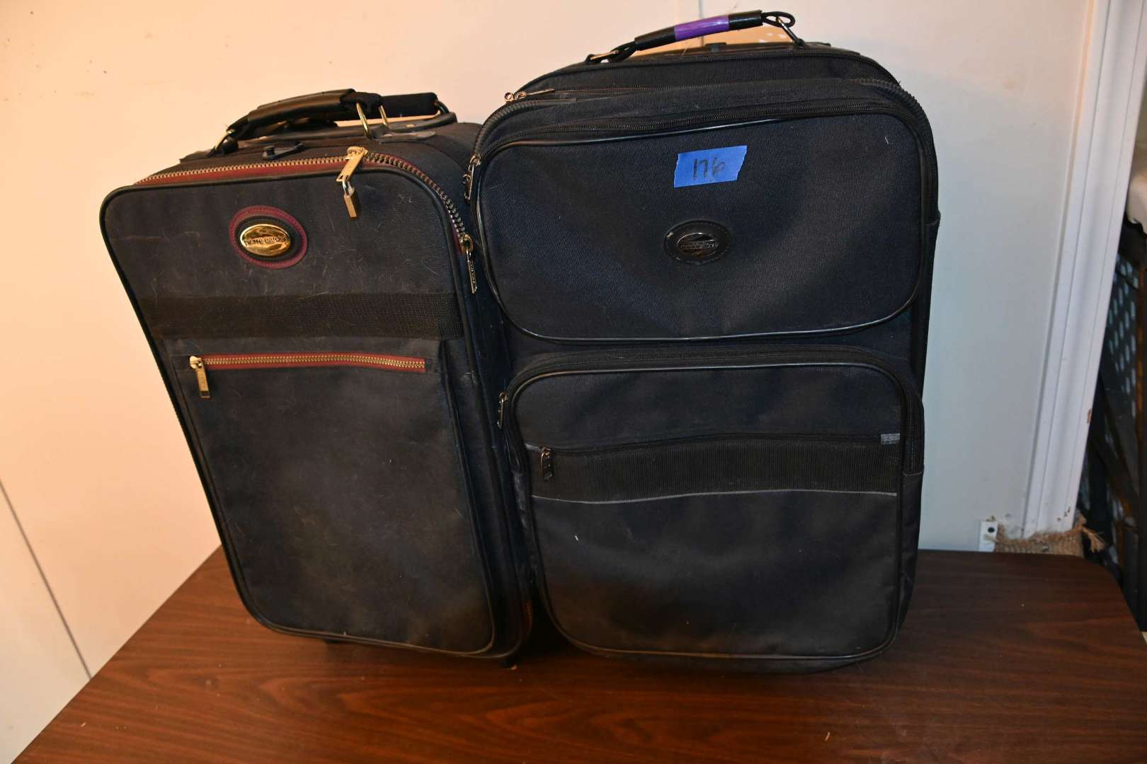 Lot # 176 Two carry on rolling suitcases