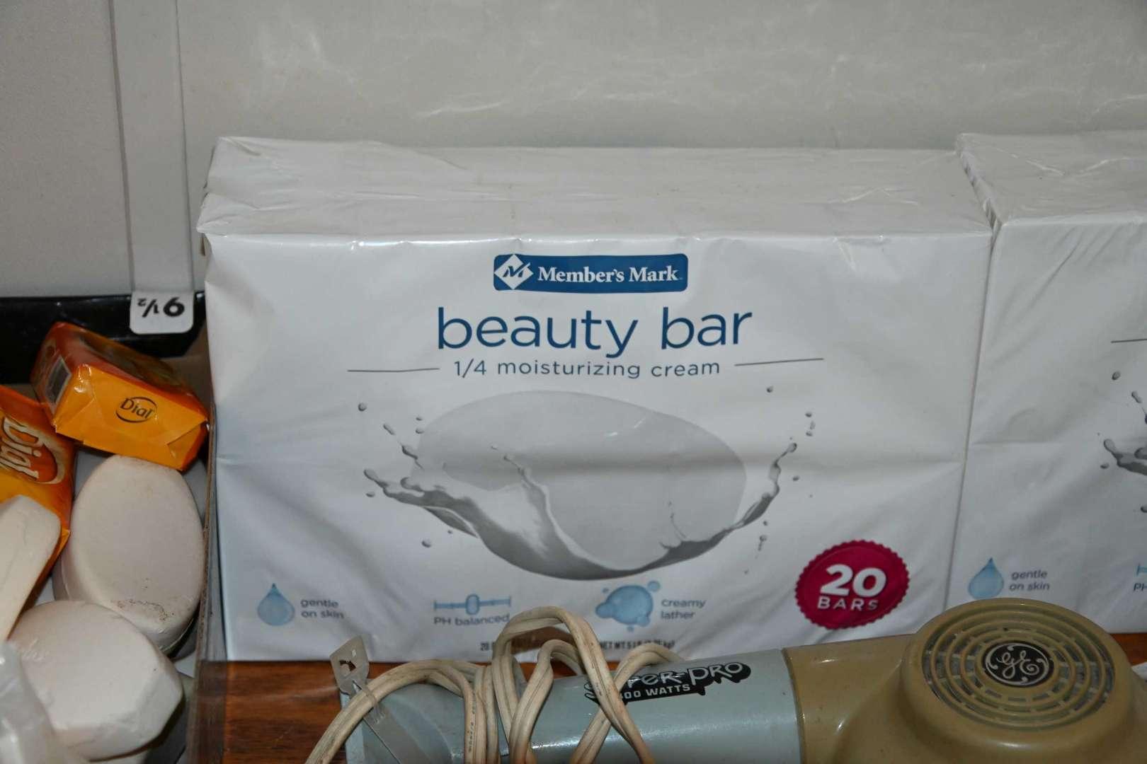 Lot # 202 Hand soap, beauty soap, hair dryer & iron
