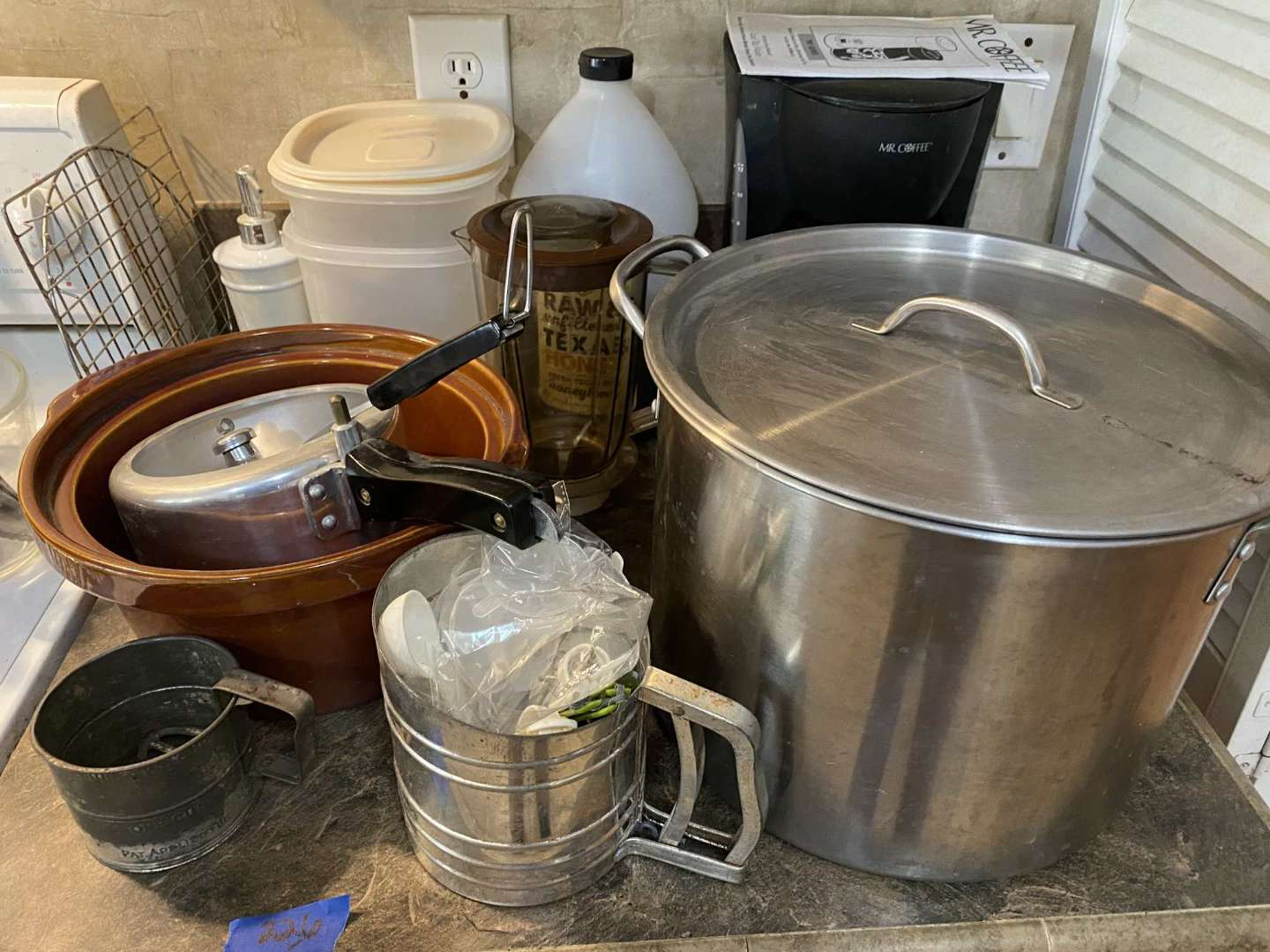 Lot # 226 Contents of right stove countertop