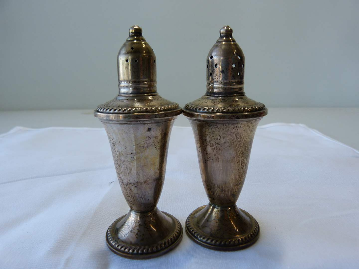 Lot # 7  Vintage pair STERLING silver salt & peppers (weighted & glass inserts) (main image)