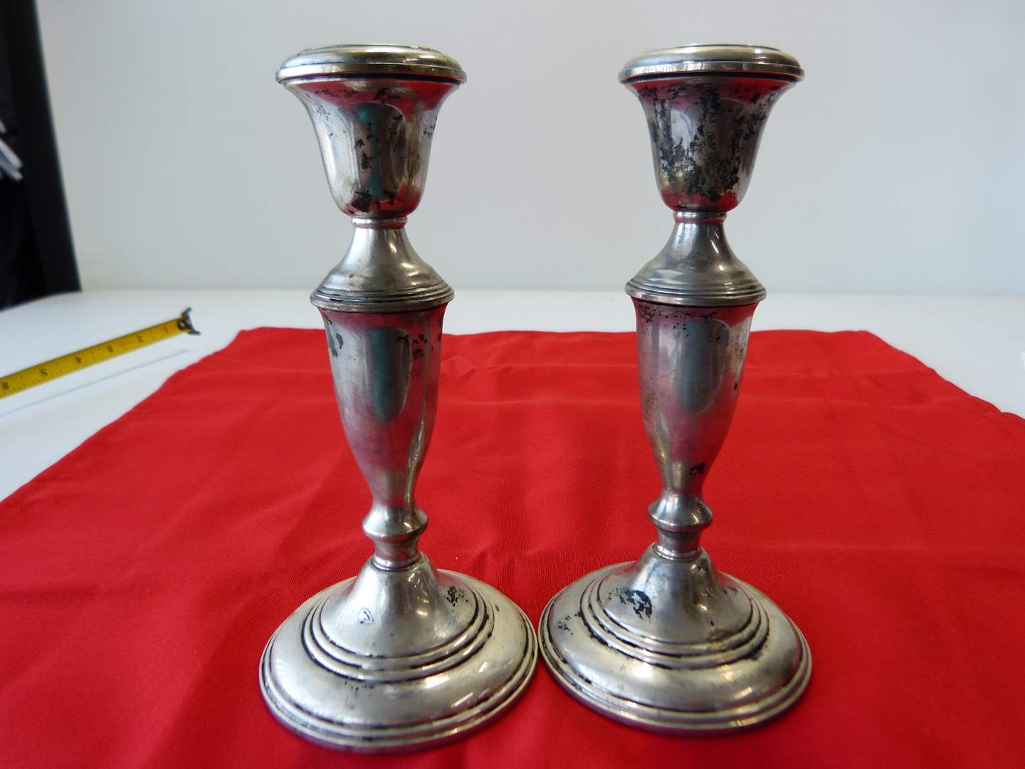 Lot # 8  Tall pair STERLING silver candle holders (slight dings consistent with age) (main image)