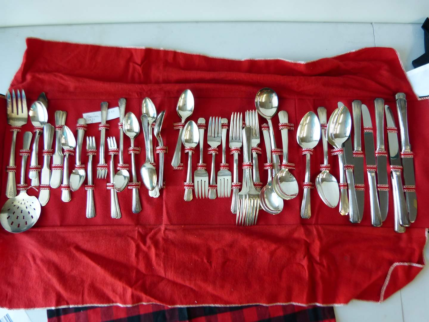 Lot # 74  Great set of silver plate flatware in folding pouch  (main image)