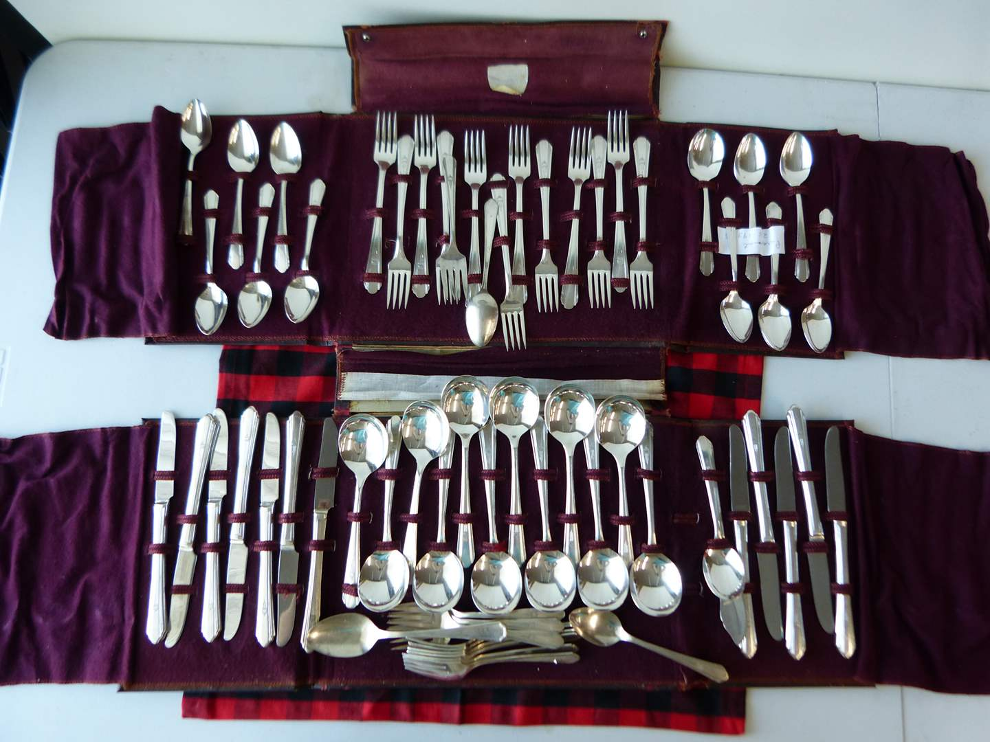 Lot # 76  LARGE set of Silver Plate flatware in folding case (main image)