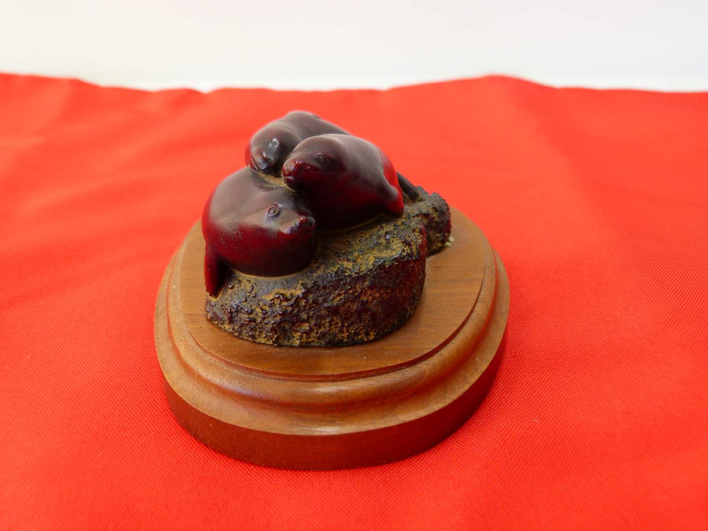 Lot # 101  Great miniature Boma Seals on rock & wood base figure (made in Canada) (main image)