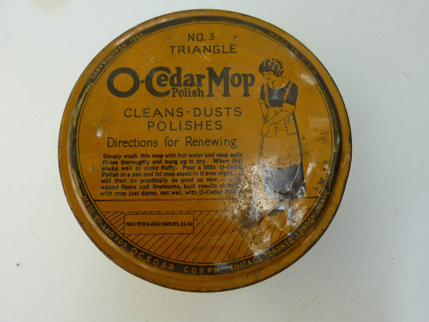 Lot # 124  Vintage O-Cedar Mop tin full of vintage buttons (100's) (main image)