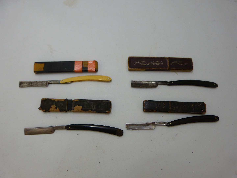 Lot # 178  Nice lot of antique straight razors (razors may not match the case) (main image)