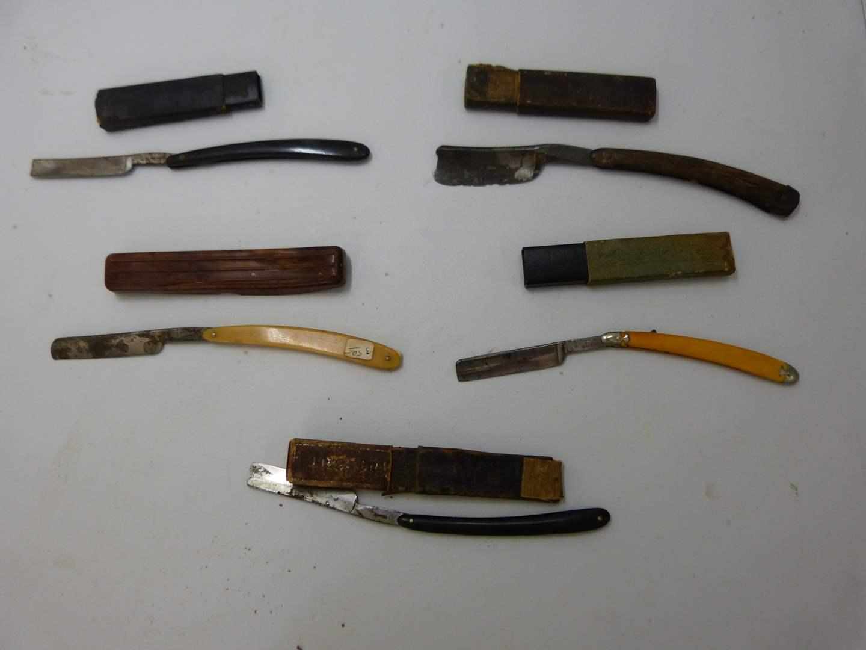 Lot # 180  Nice lot of antique straight razors (razors may not match the case)   (main image)