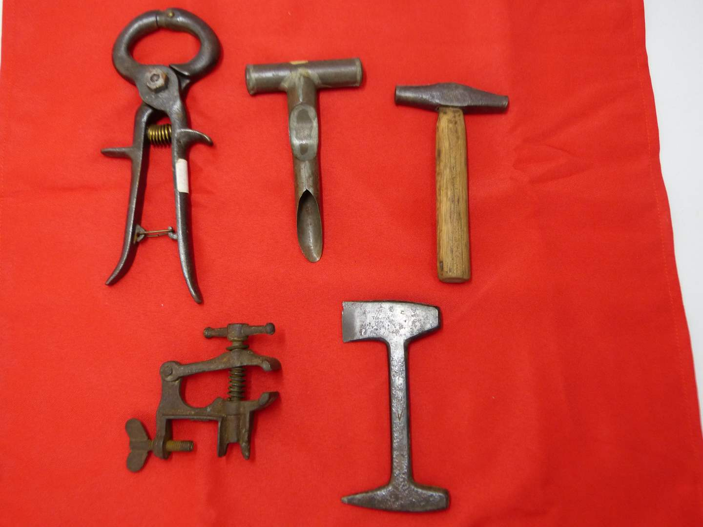 Lot # 193  Collection of primitive tools to include a maple syrup tapper (main image)