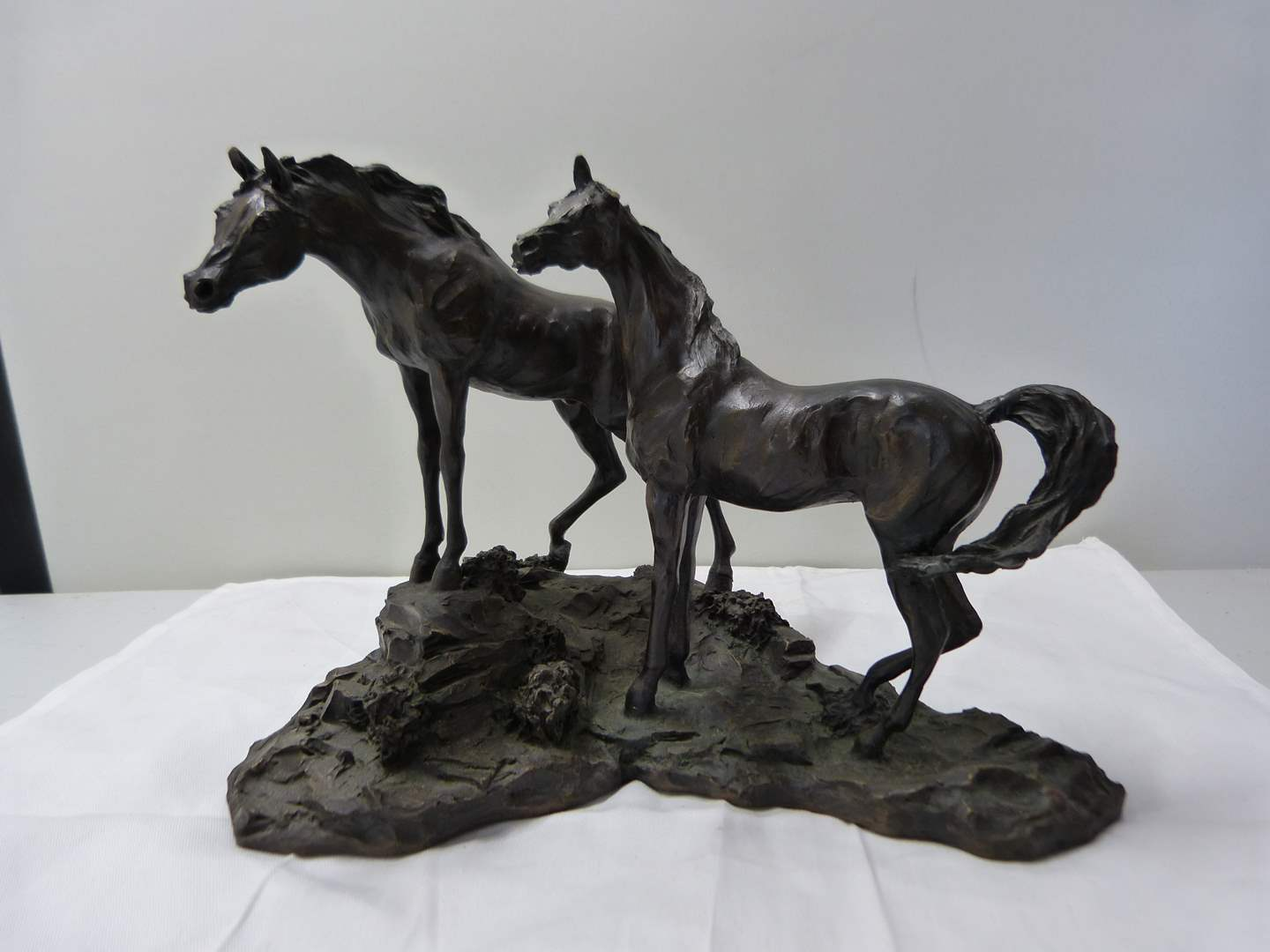 """Lot # 267  """"Intruder"""" by Lanford Monroe Bronze horses (Franklin Gallery) one horse is missing an ear (main image)"""