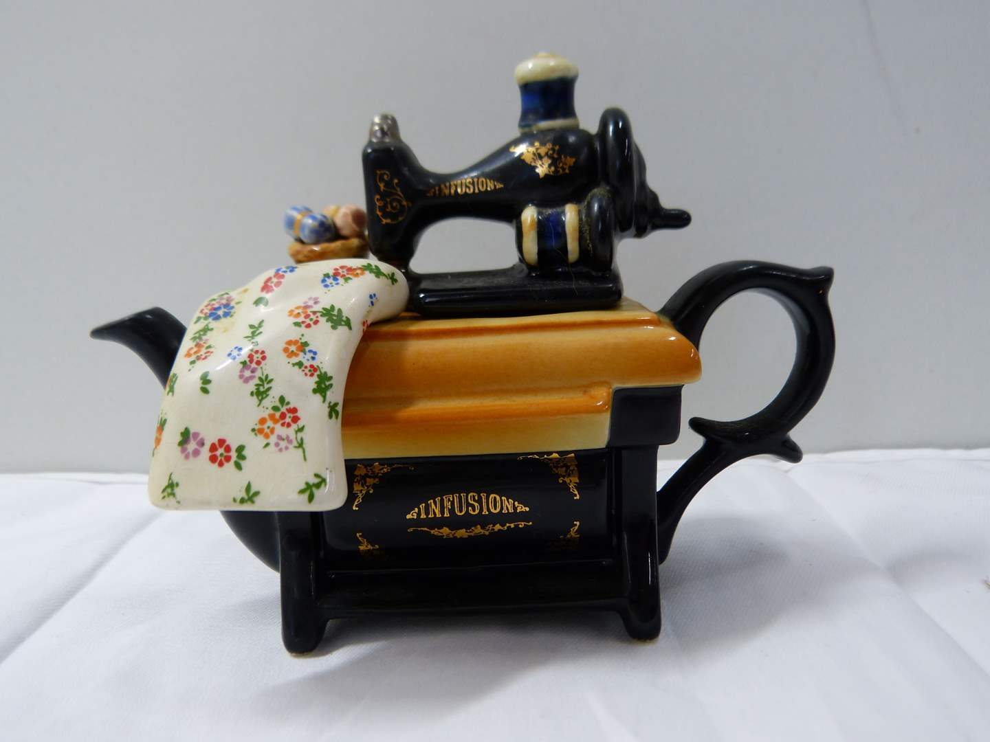 Lot # 283  Great miniature Made in England animated teapot (main image)
