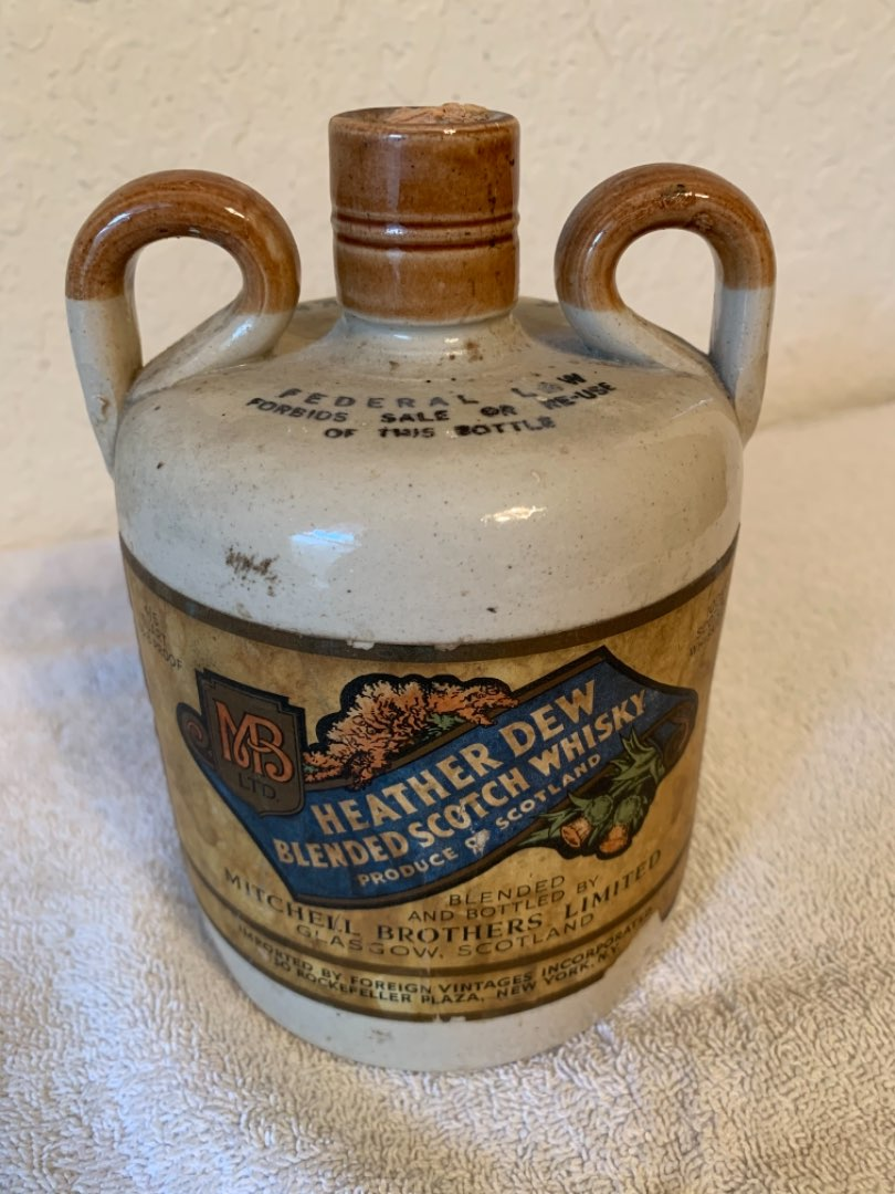 Lot # 67 Very Old Heather Dew Scotch Whisky Stoneware Jug. Great Advertising