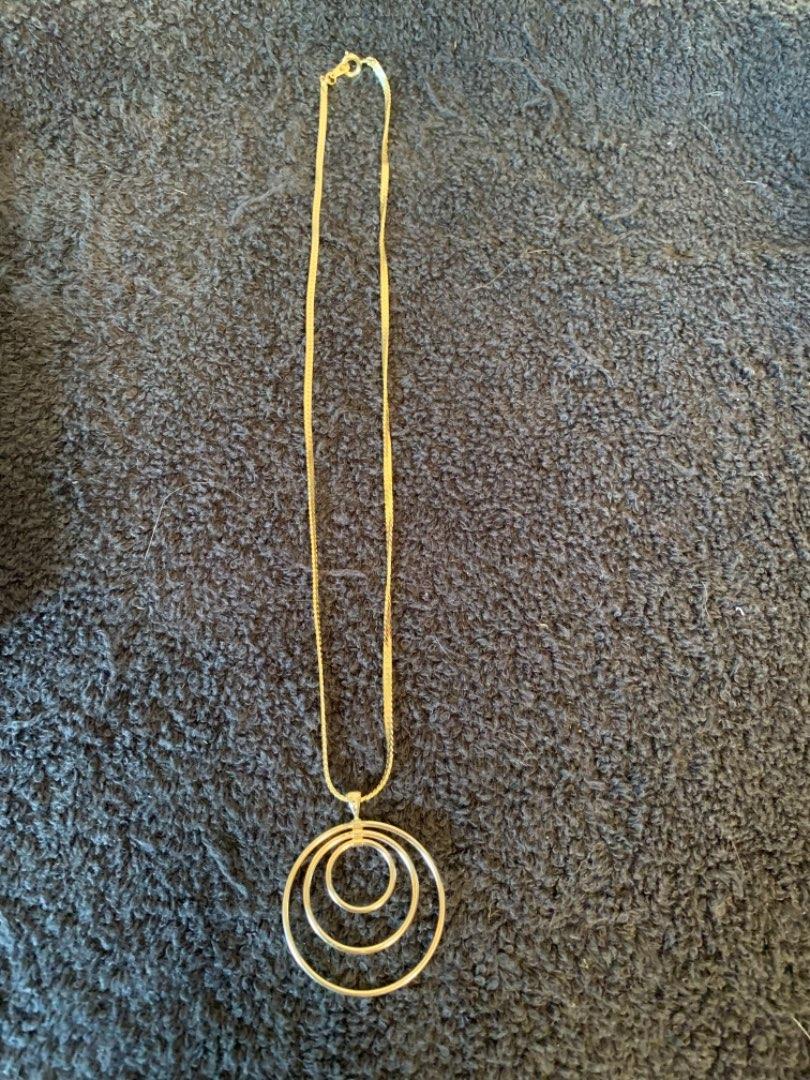 Lot # 141  Stamped 14K Pendant. 1.39 Grams. Chain Tests As 10k. 4.29 Grams. See Below