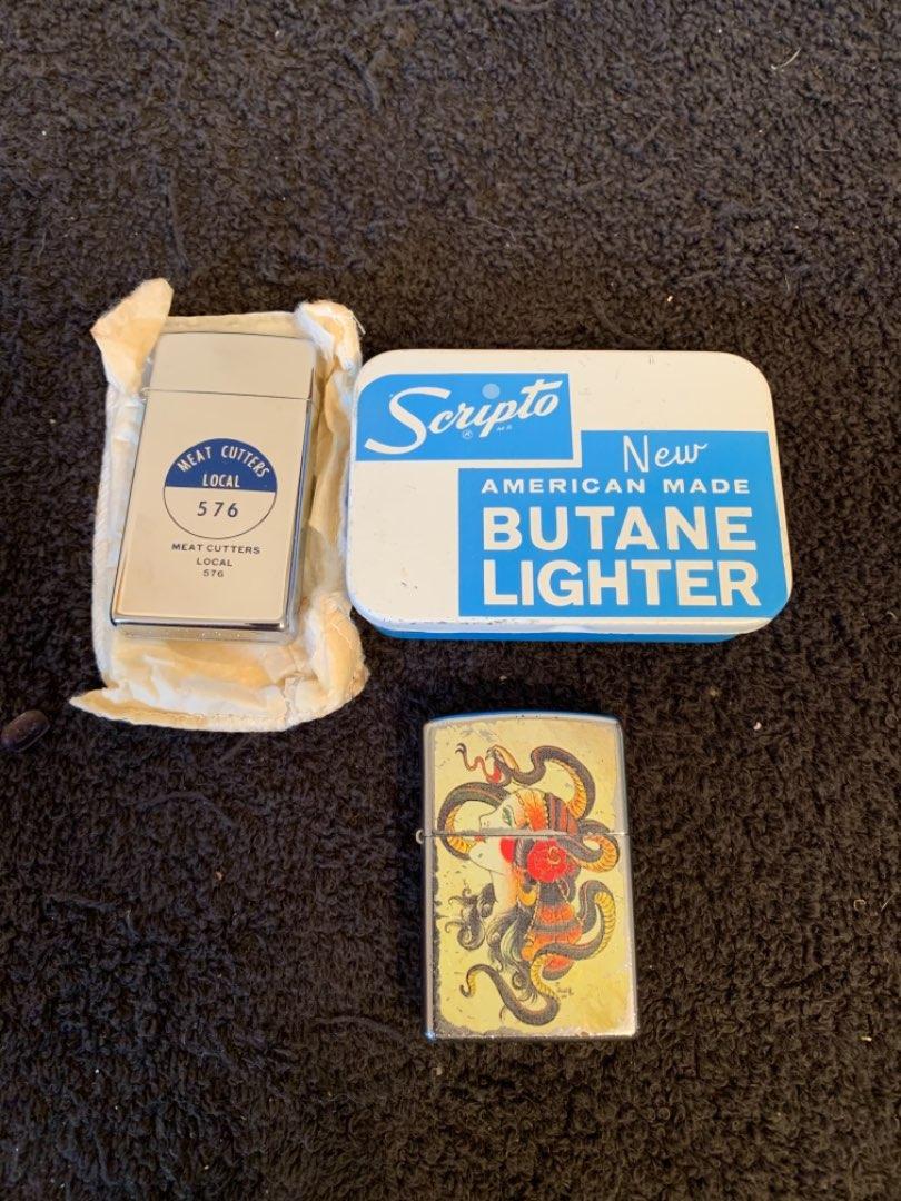 Lot # 199  Vintage NIB Scripto Butane Lighter & A Zippo.
