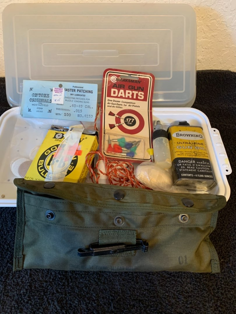 Lot # 250 Assorted Gun Cleaning Supplies Including A Military Style Carry Bag