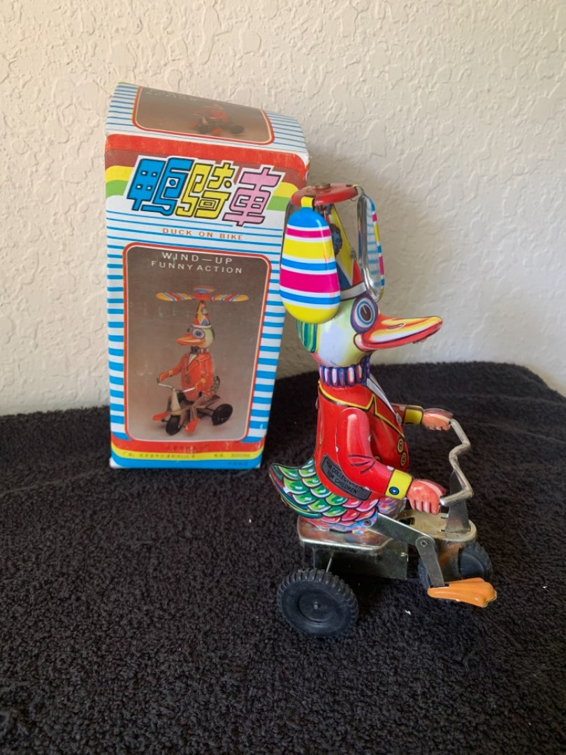 Lot # 262 NIB Working Tin Wind-Up Duck On Bike.