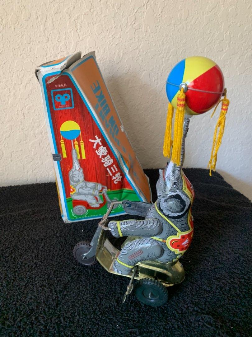Lot # 263  NIB Working Tin Wind-Up Toy. Elephant On A Bike