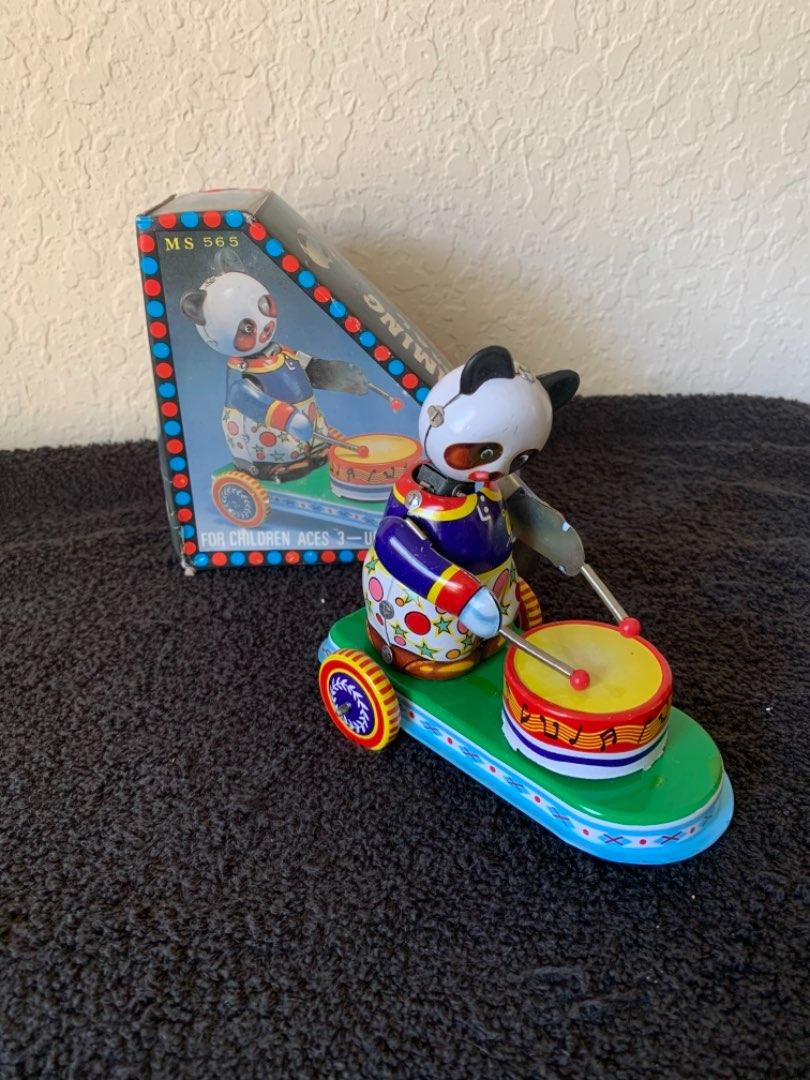Lot # 264  NIB Working Tin Wind-Up Toy. Drumming Animal