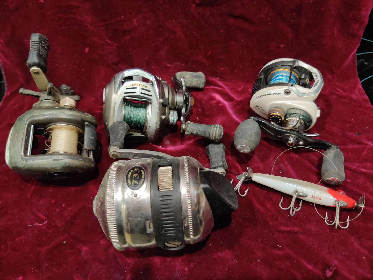 # 75 lot of four baitcasting fishing reels and one lure