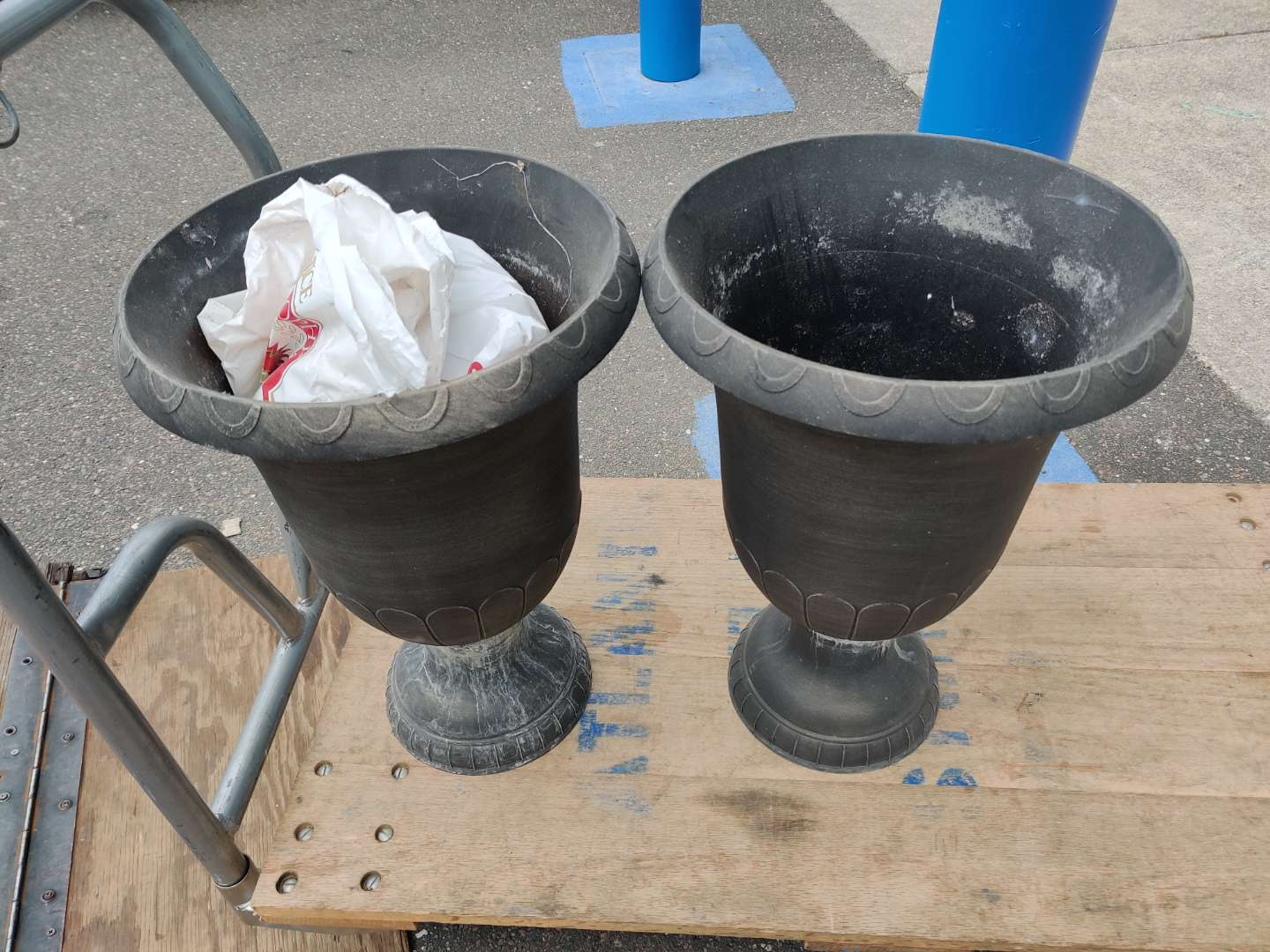 # 84 pair of some type of composition or plastic 22-in tall planters