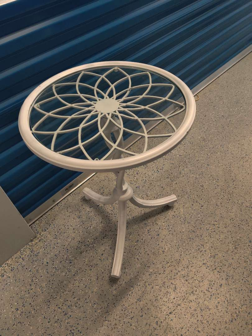 # 90 very nice white metal table with a glass top 26 in tall 18 in wide Nice condition