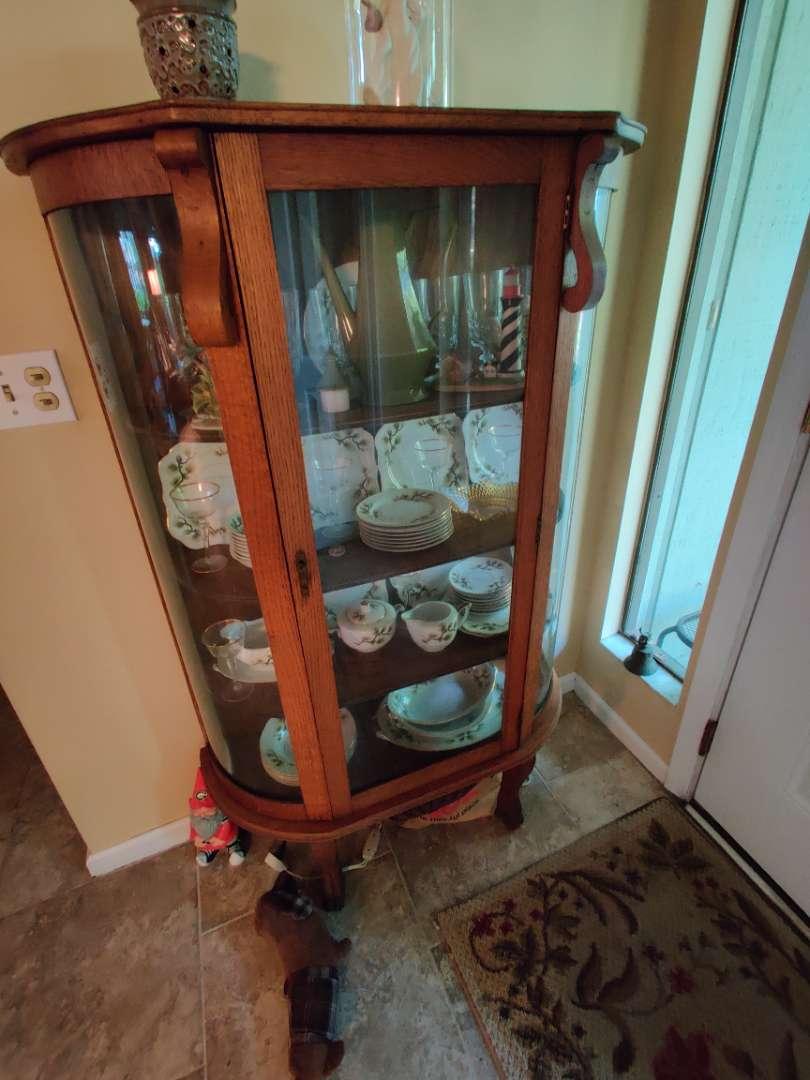 # 106 oak Bow front curio cabinet no contents
