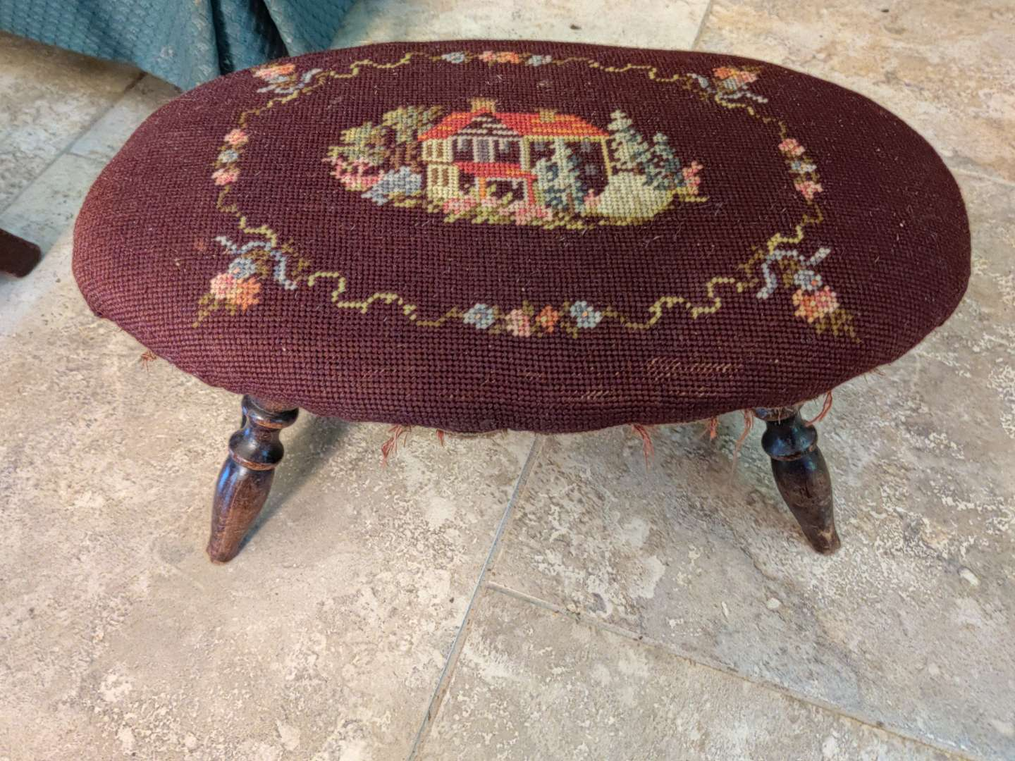 # 110 antique needlepoint covered footstool