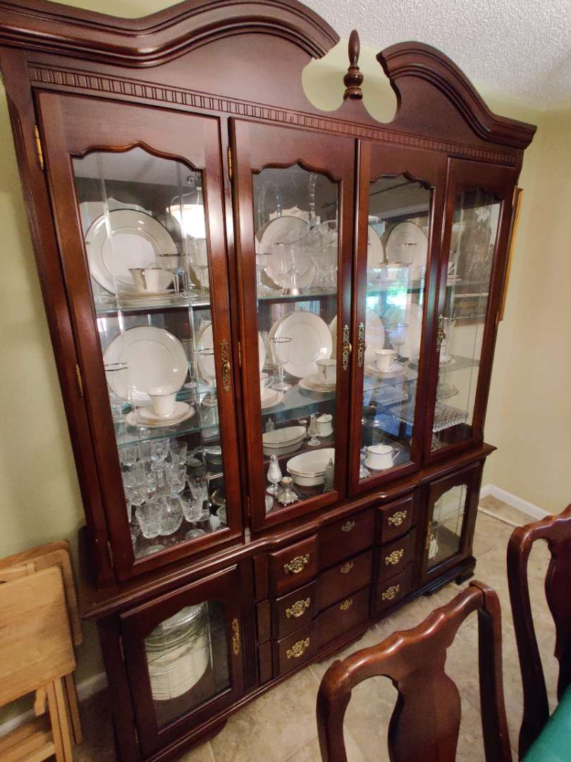 # 113 Cherry china cabinet by singer 69 in wide 88 in tall lighted and great condition