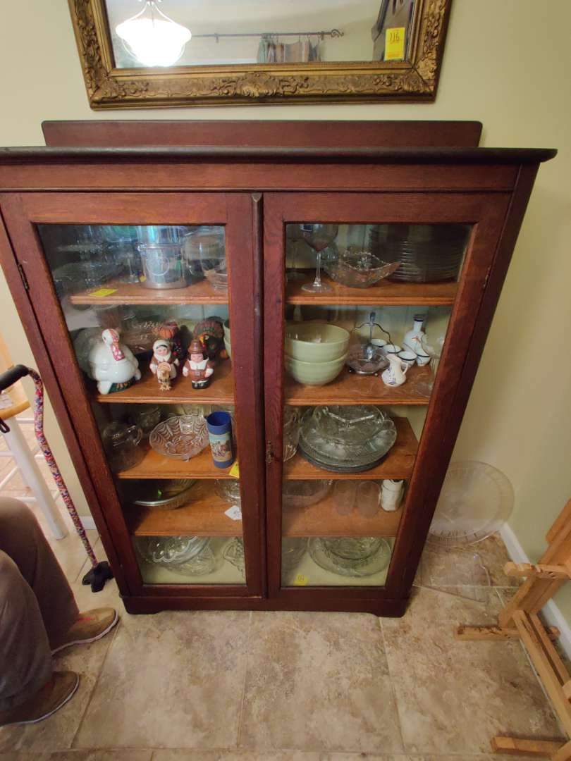 # 125 mission oaks style glass front bookcase with key no contents
