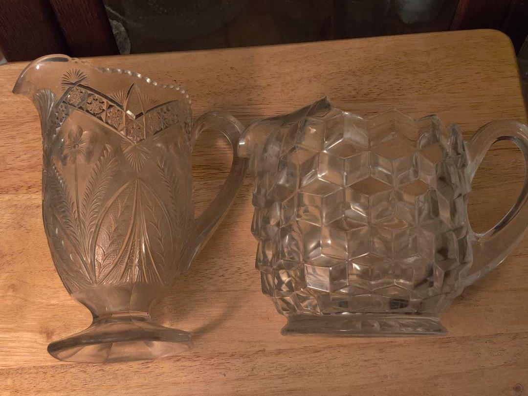# 132 lot of two patterned glass water pitchers one is American fostoria