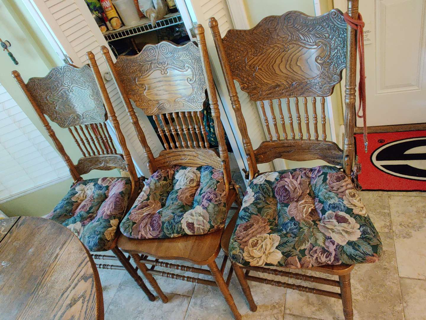 # 142 set of three oak pressed back chairs with cushions