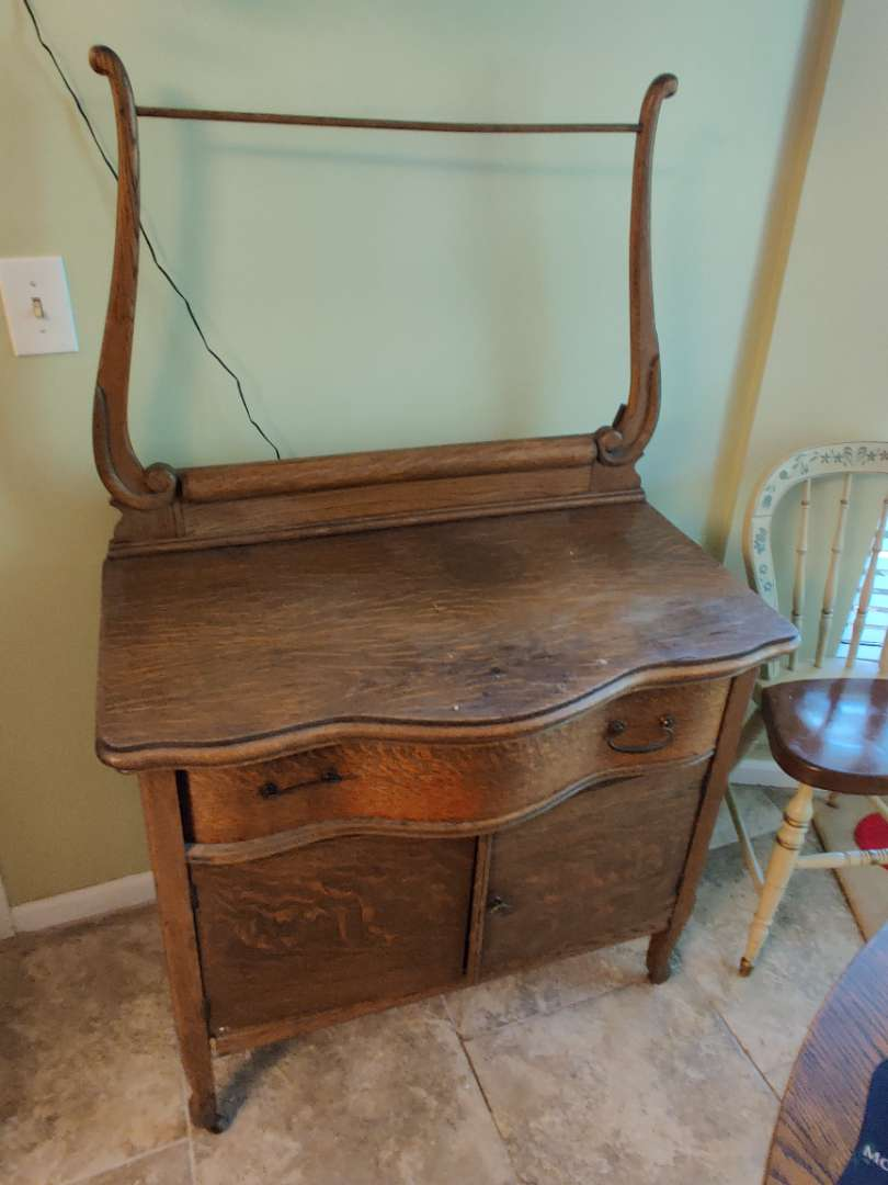 # 144 oak Wash stand two doors one drawer serpentine front with the towel rack Nice condition