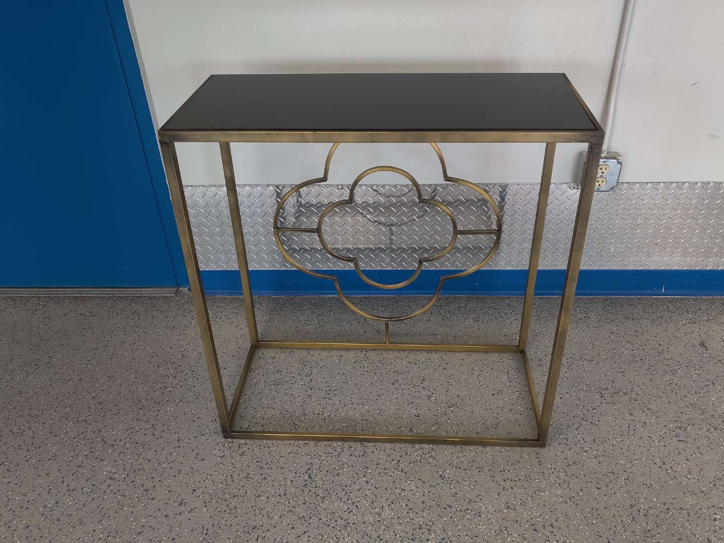 # 152 modernistic sofa table metal with black top 32 inches tall 32 inches wide great condition
