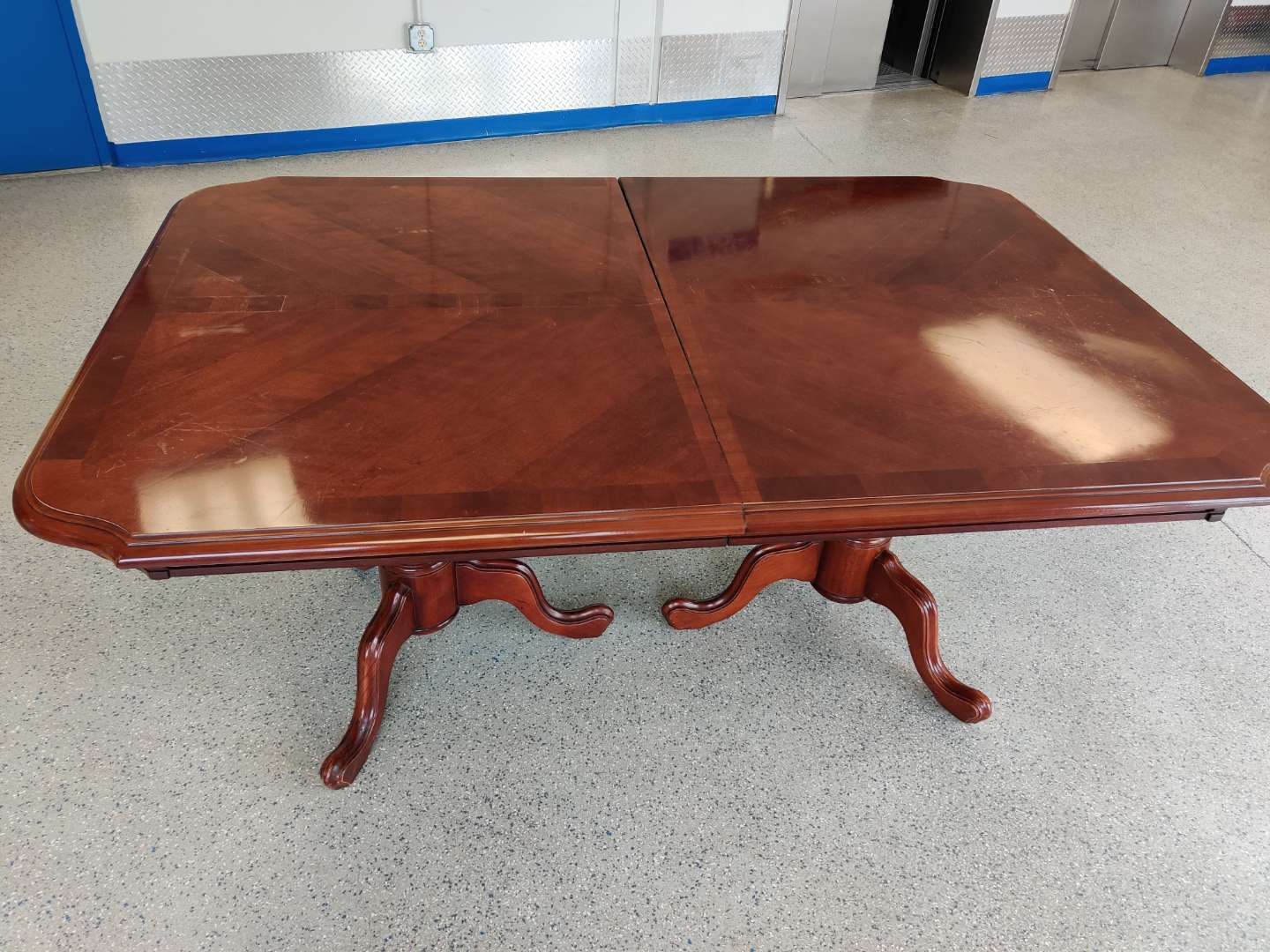 # 160 Lexington furniture dining room table with two leaves top is kind of rough got some scratches and it is separated tw