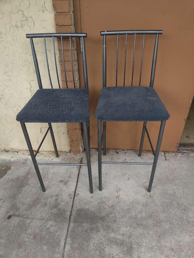 # 171 pair of metal bar stools with gray cushions
