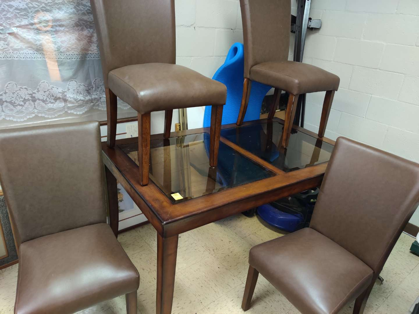 # 184 table and four chairs smoked beveled glass 6 ft long 3 ft wide PVC brown leather chairs