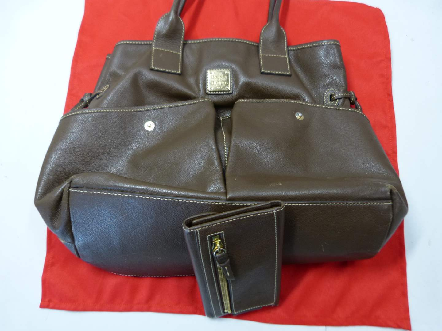 Lot # 204  AUTHENTIC Dooney & Burke bag (nice outside, needs cleaning inside)
