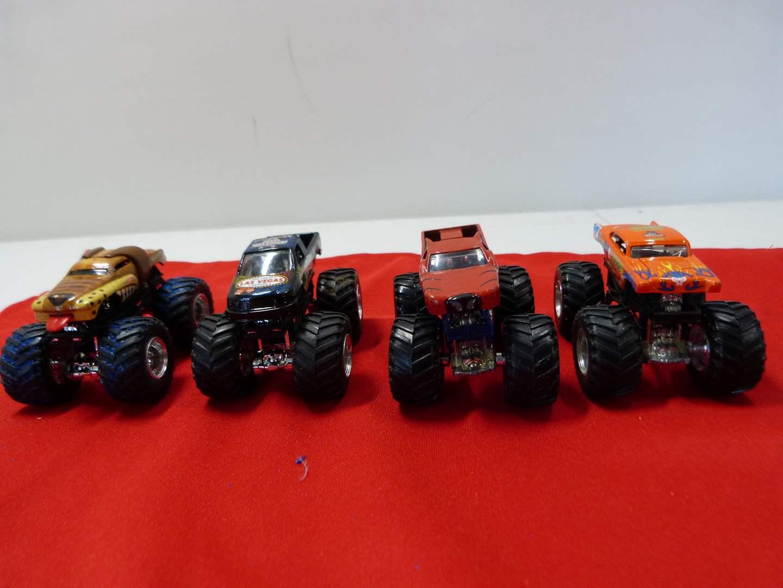 Lot # 210 Lot of monster trucks (very little use) (main image)