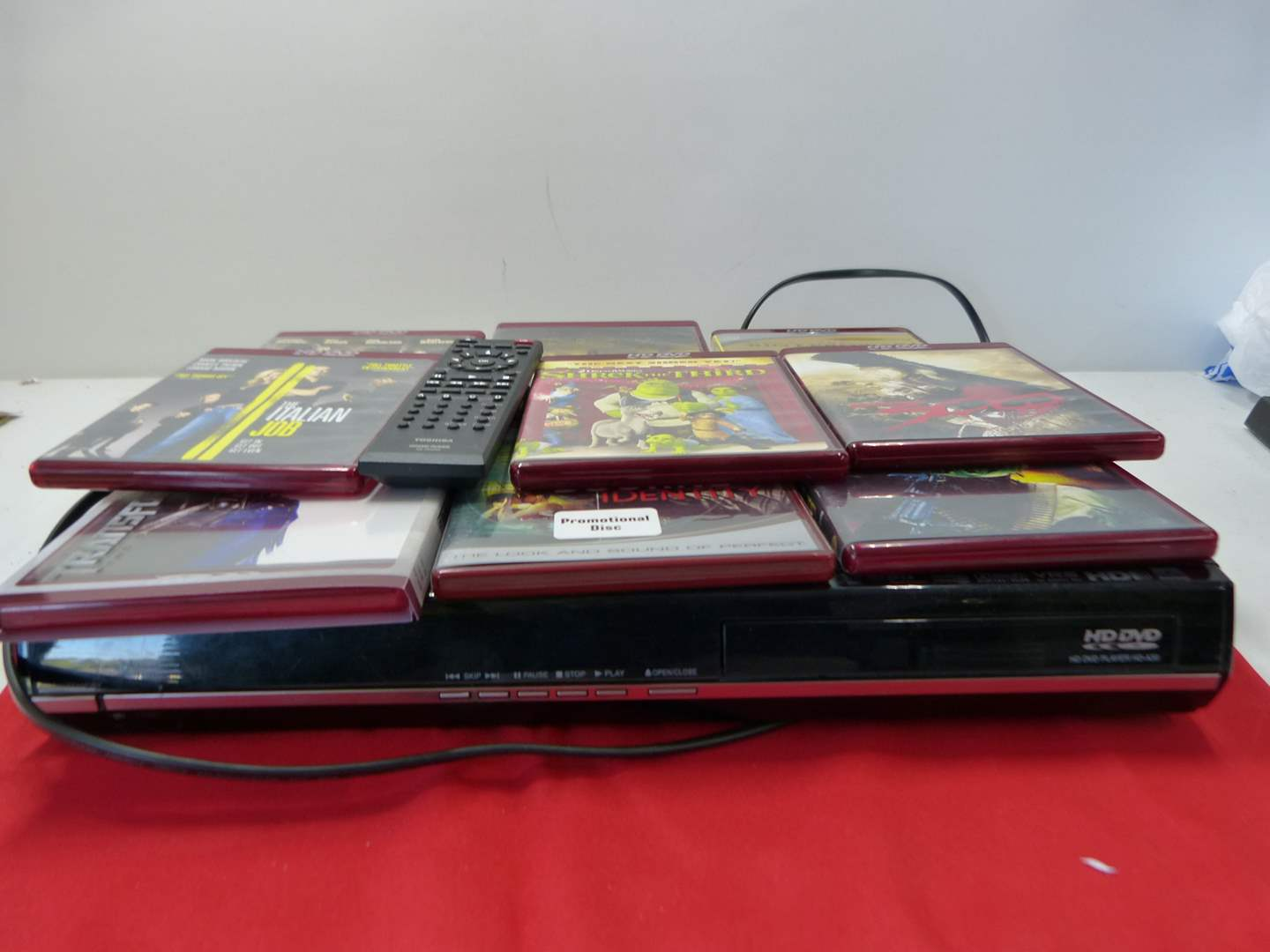 Lot # 223  Specialty HD-DVD player with DVD's & remote (needs batteries and battery holder) read below