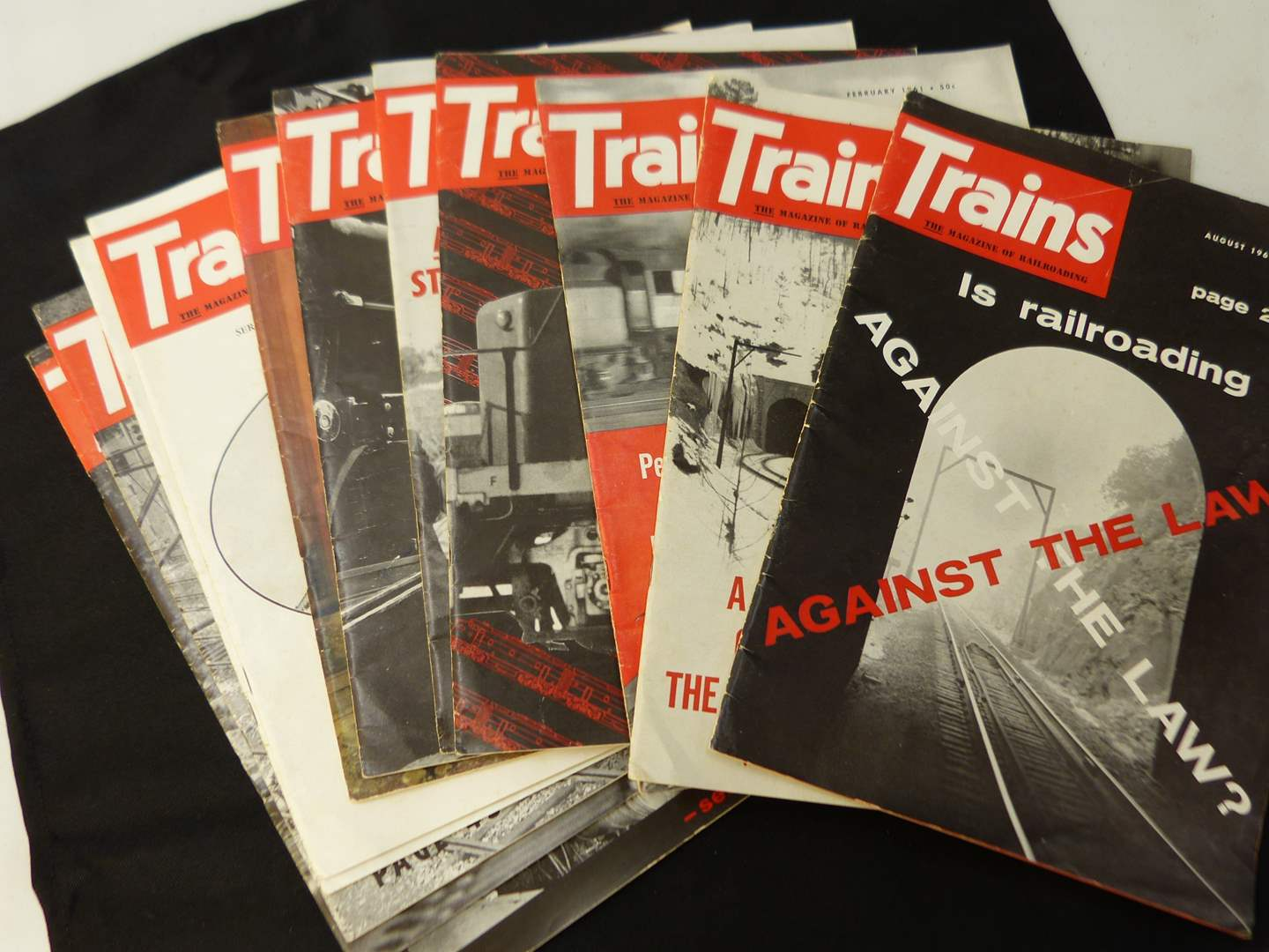 """Lot # 267  Trains """"The Magazine of Railroading"""" 1961 full year (magazines are complete-great advertising & stories)"""