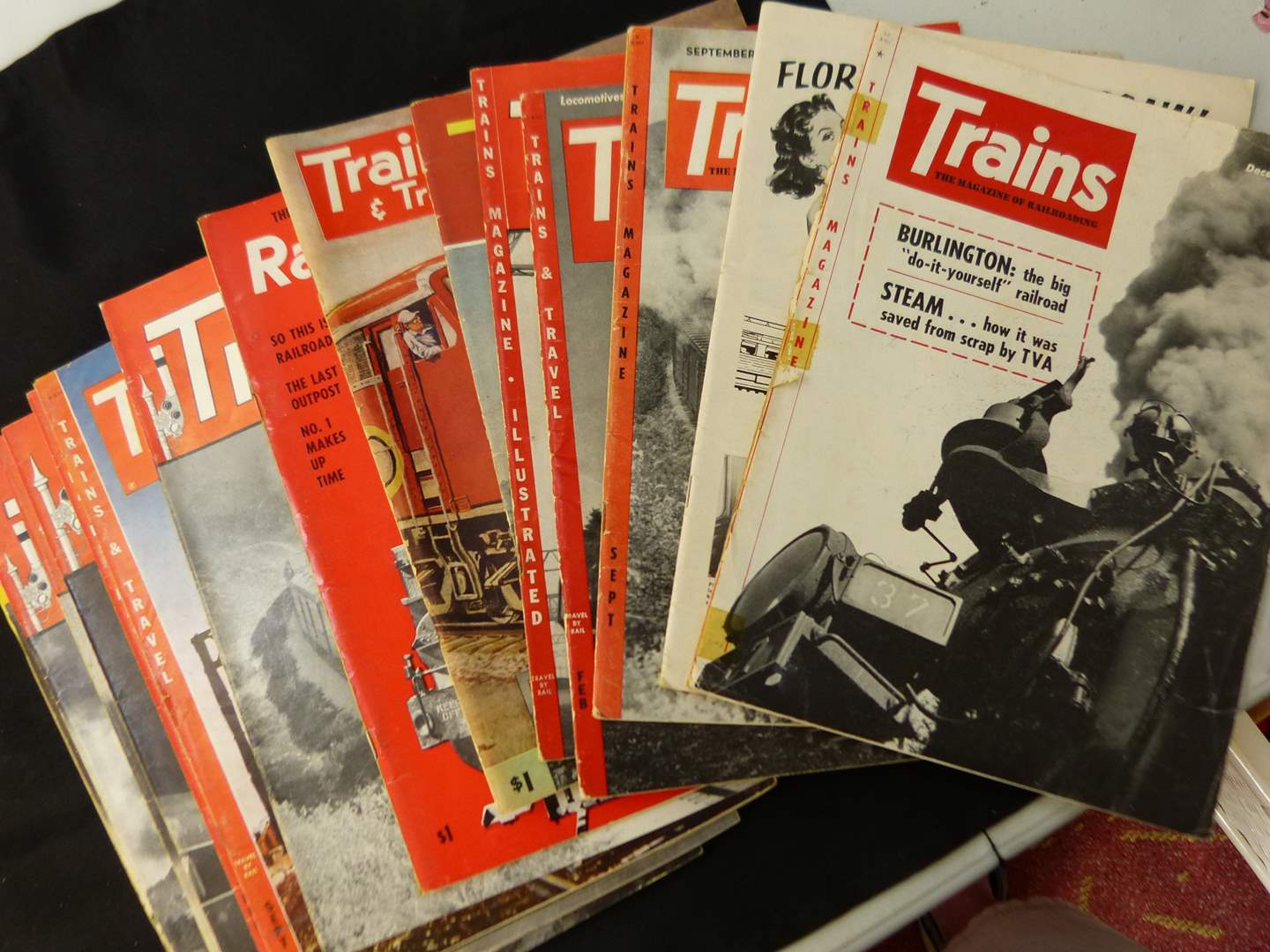 """Lot # 270  Trains """"The Magazine of Railroading"""" 1955 full year (magazines are complete-great advertising & stories)"""