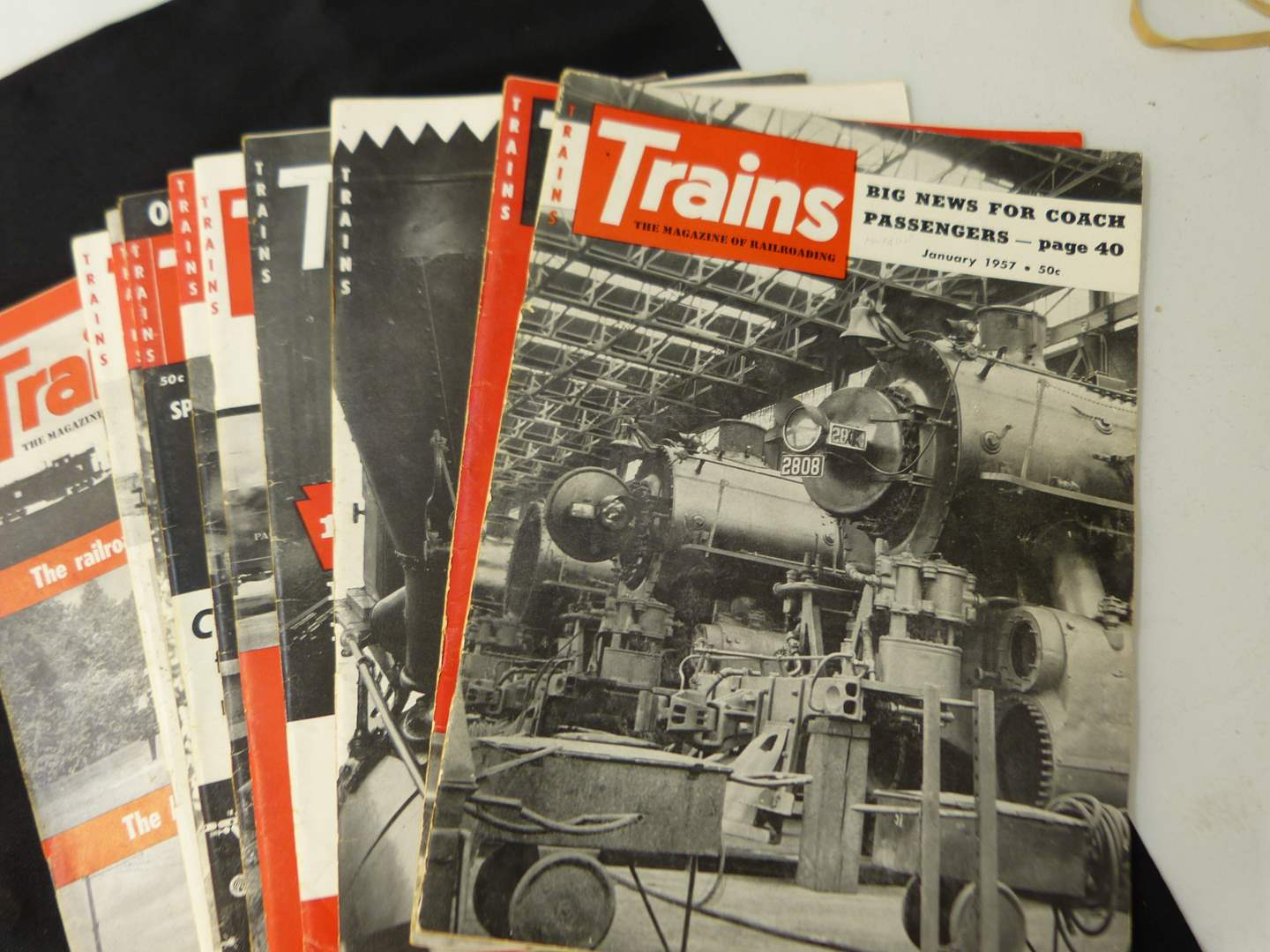 """Lot # 273  Trains """"The Magazine of Railroading"""" 1957 full year (magazines are complete-great advertising & stories)"""