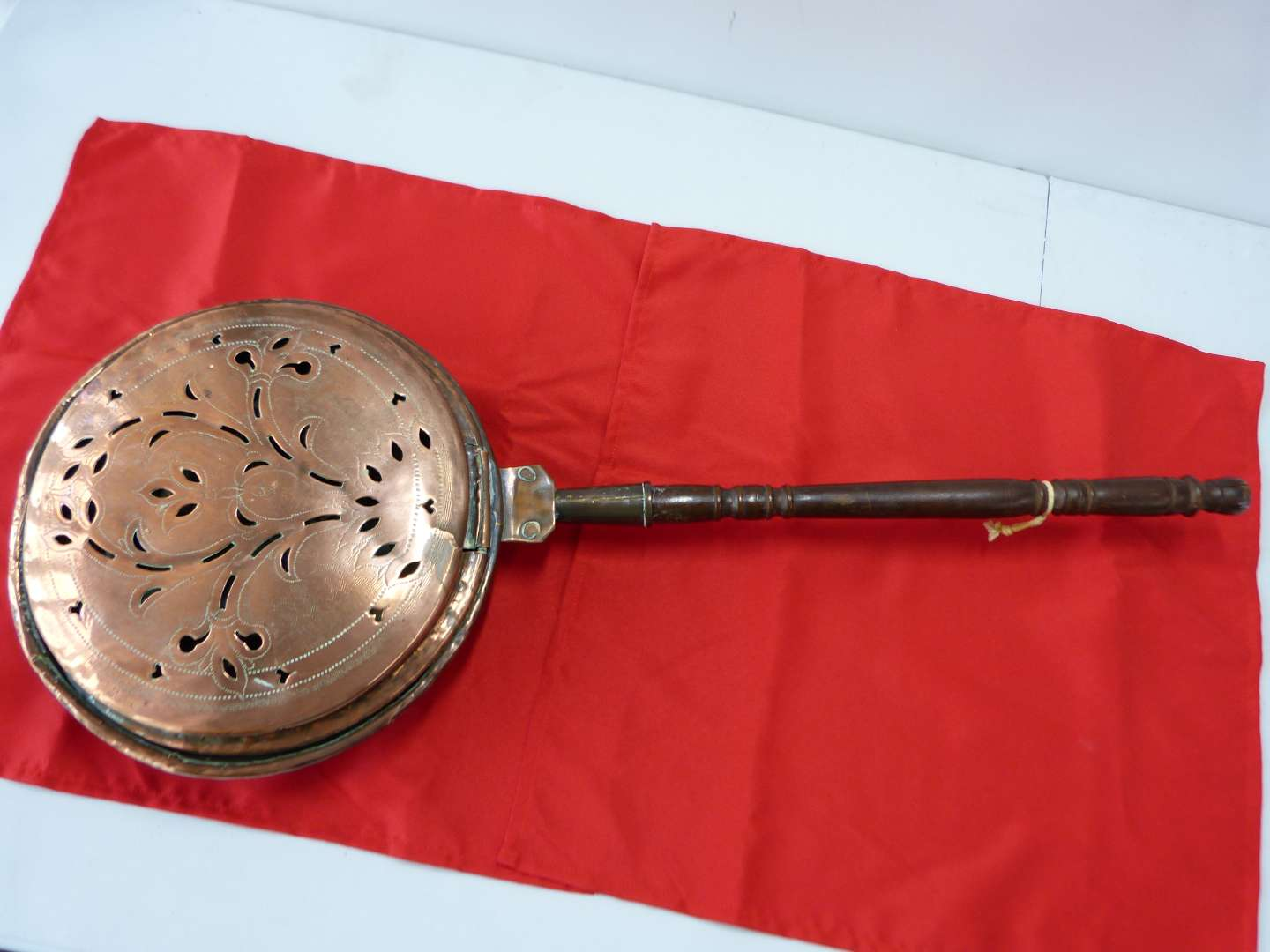 Lot # 17  Antique wood and copper bed pan warmer w/great pierced look (good condition for the age)